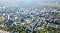 Aerial view, landscape part of the modern city and private homes spring sunny day Kyiv, Ukraine. Photo from drone