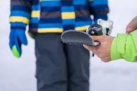 Ski instructor holding ski