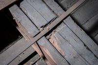 weak wooden floor beam in old attic / loft with support construction