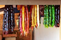 Churchkhela. Traditional Georgian homemade sweets with hazelnuts, walnuts, grape juice, honey sugar , wheat flour corn flour . Dessert is sold in the market near the embankment near the Black Sea. Republic of Crimea