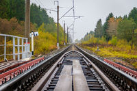 Russian railway. Rails sleepers contact network. Journey. Railway in the fall.