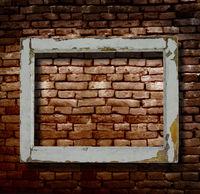 Window frame and brick wall