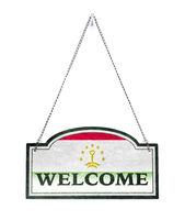 Tajikistan welcomes you! Old metal sign isolated