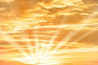 Orange sunset sky with clouds