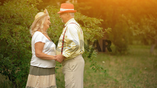 The Old Couple Near The Trees