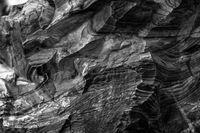 Natural black volcanic stone texture venetian plaster background. Dark volcanic rock venetian plaster stone texture grain pattern. Black grunge charcoal background texture rock