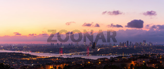 The Bosphorus Bridge and the night lights of Istanbul, aerial panorama