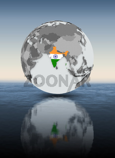India on globe above water