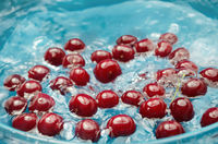 Ripe cherry in water, washed