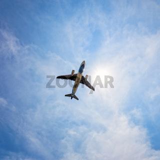 Below jet plane flying on sky