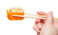 wood chopsticks holds california ebi roll isolated