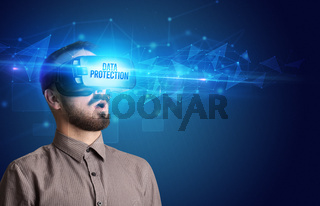 Businessman looking through Virtual Reality glasses, virtual security concept