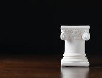 White Ionic Design Column on Dark Background