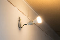 Light bulb hanging on a wall