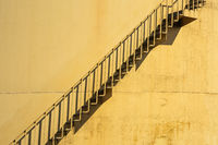 Abstract view with shadows at staircase fuel storage tank