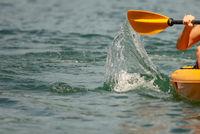 abstract kayak action on a mountain lake