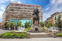 Urban square with bronze sculpture of Queen Isabella and Christopher Columbus in Granada, Spain