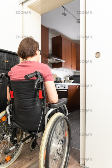 disabled woman at the open door to the kitchen