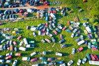 Car wrecks on meadow aerial view