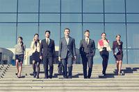 Business people walking down stairs
