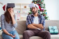 Happy family using virtual reality VR glasses during christmas