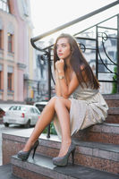 Charming young lady posing on the street.