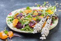 Organic arugula salad, tangerine and baked beetroot.