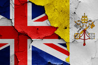 flags of UK and Vatican painted on cracked wall