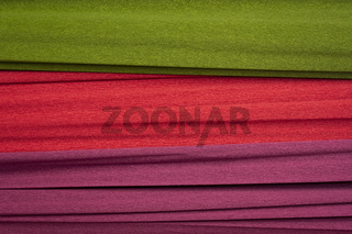 red, green and purple crepe paper background