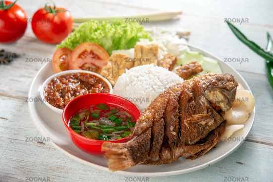 Fried tilapia fish and rice