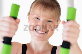 Girl doing dumbbell exercises