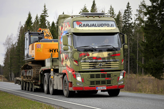 Customized Volvo Truck Hauls Excavator