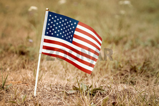 United States flag in the ground