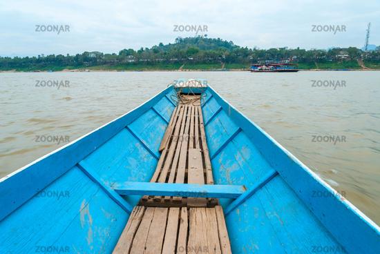 Crossing Mekong river by boat