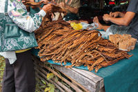 Dried tobacco leaves are for sale in a local market in Philippines. Malatapay street market