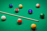 Billiard balls on pool green table