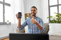 male blogger with smartphone videoblogging