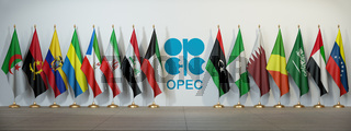OPEC. Symbol and flags of OPEC countries.