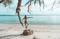 Girl at idyllic beach in early morning, balance, fitness, freedom