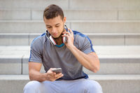 Listening to music young latin man smartphone listen copyspace copy space