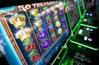 Computer monitor of slot machines in casino