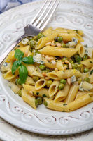 Penne pasta with green peas.