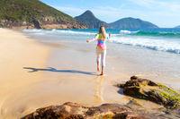 Woman running along the beach