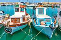 Old fshing boats in the port of Heraklion