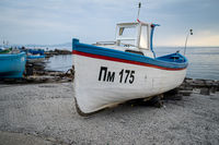 Fishermen's boats stand on the shore of the seaport of the seaside resort town of Pomorie.