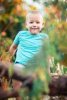 Outdoor portrait of cute little boy