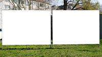 two blank billboards side by side