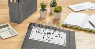 A folder on a desk with the label Retirement Plan