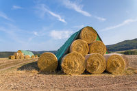 Stack of straw rolls in german field