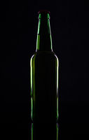 Green beer bottle, isolated on black background